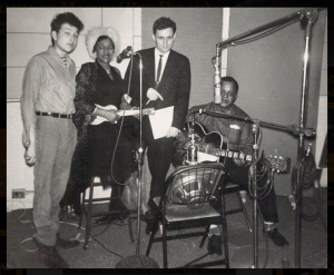 A-very-young-Bob-Dylan-with-Big-Joe-Williams-seated-1962